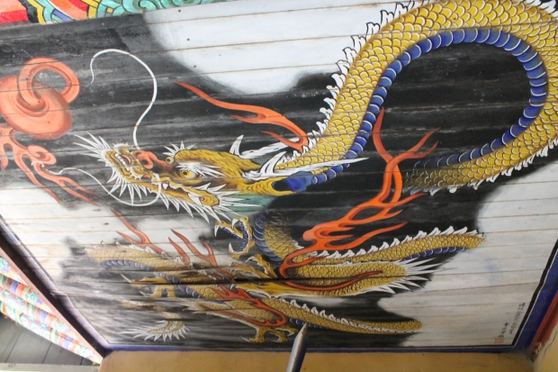 Cool dragon painting on the ceiling of the temple gate.