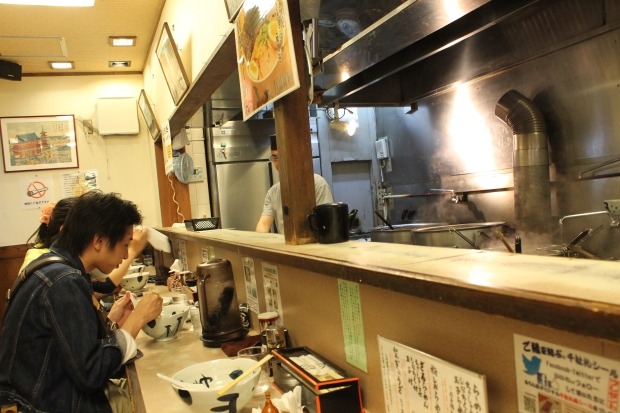 The ramen shop was a super narrow hole-in-the-wall with just one long counter where you sit and eat what these guys cook up for you.