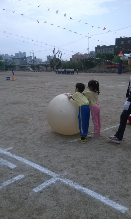 The first-graders had to roll this giant ball around a cone and back in pairs. It was unbelievably adorable.
