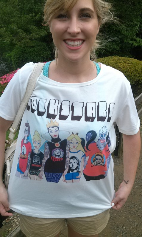 Belle has a sleeve of tattoos and glasses and is wearing a Bazinga shirt. What's not to like?