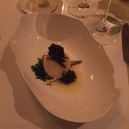 American sturgeon caviar atop a butter poached turnip with some greens I don't know the name of.