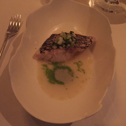 Sea bass topped with something and poblano peppers swimming in a coconut cream, mint and lemongrass sauce.